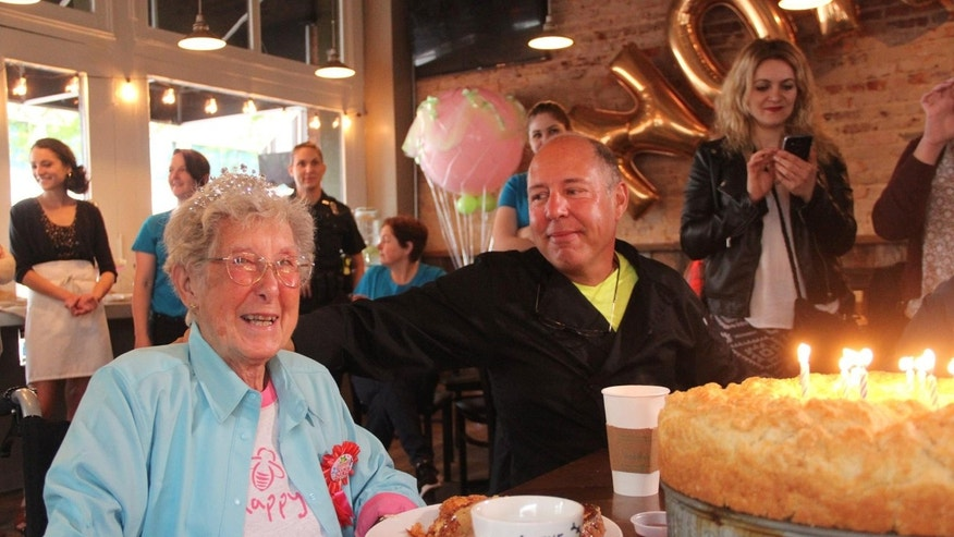 Norma, pictured here in Marietta, Georgia, celebrating her 91st birthday, forewent cancer treatment in August to take a cross-country road trip with her family and their poodle.