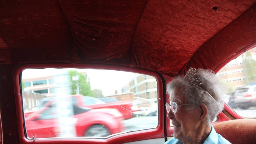 Norma wore a crown and drove into historic Marietta Square in a red, 1995 Chevrolet Bel Air.