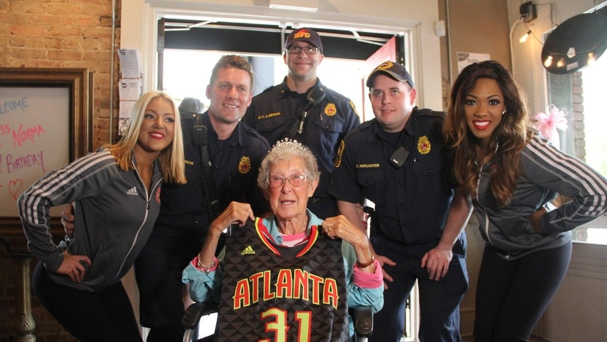 Local firefighters and two Atlanta Hawks cheerleaders joined in on the celebration for Norma.