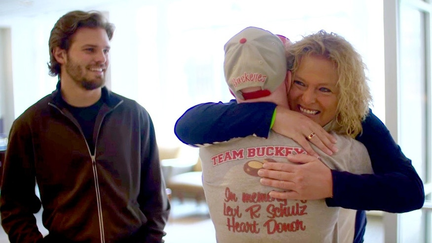 In this Friday, April 1, 2016 image made from video provided by Nebraska Medicine, Lisa Swanson meets Terry Hooper for the first time after the Nebraska man received her son's heart, in Omaha, Neb. Hooper received the heart on Dec. 10, 2012, three days after 18-year-old Levi Schulz of Horace, North Dakota, died in a car crash. Schulz's twin brother, Shelby Schulz is at left.(Dave Hynek/ Nebraska Medicine via AP)