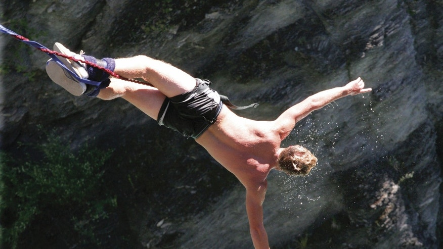 A man bungee-jumping.