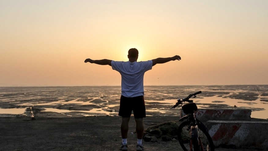 A man exercises early morning along the Arabian Sea in Mumbai