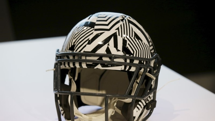 A new impact absorbing helmet is displayed at the NFL Headquarters in New York