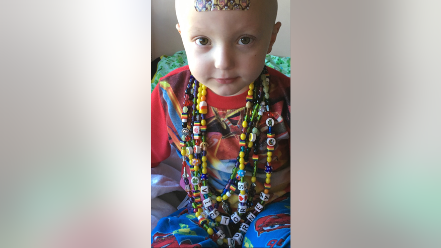 "Victor Sciarrotta, 5, collects beads during doctor's appointments and hospital visits as he battles a very aggressive brain cancer. His mother, Amber Sciarrotta, said he ""loves his beads"" and that they lay them around on the floor to talk about all the things they represent."