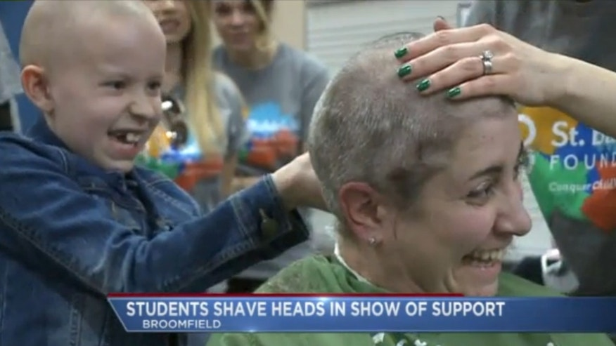 Marlee Pack shaves the head of a supporter. (Fox31)