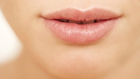 Cropped closeup image of smooth glossy pink lips - Beauty and skincare