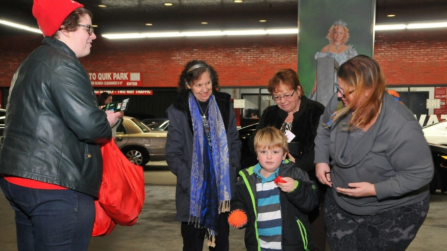 "A volunteer hands out ""fidgets"" before the February 7, 2016 autism-friendly performance of ""Wicked."""