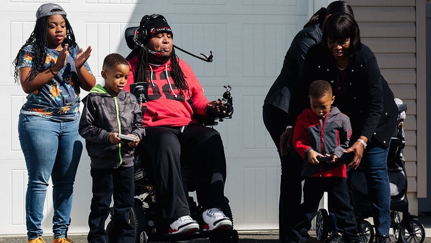 Eric LeGrand tests out 'Adaptoys' racecar with his nephews.