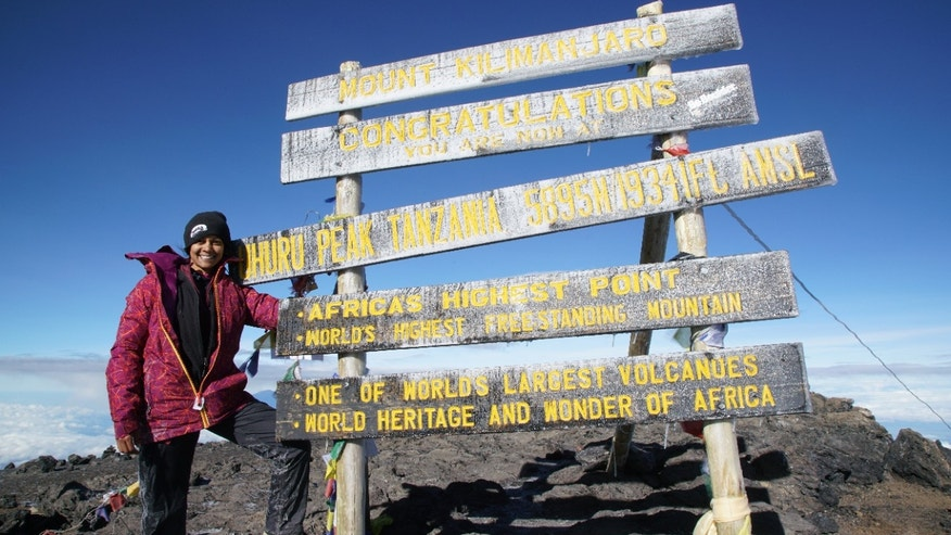 Mona poses for a photo at the summit on day No. 7 of her Mt. Kilimanjaro climb.