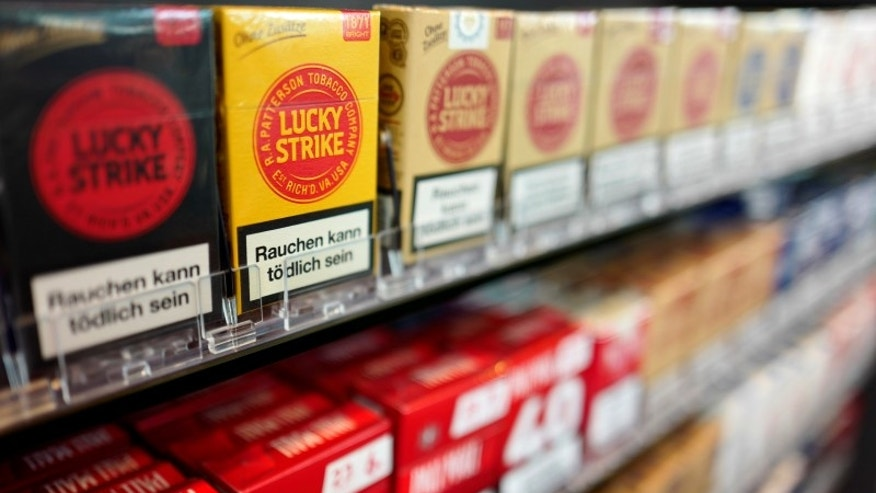 Packages with cigarettes are on display at a tobacco store in Hanau near Frankfurt