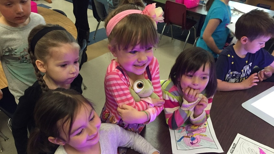 Mattea Grandaw, 5 (in the striped shirt), enjoyed a miniature Crayola Experience Tuesday at her elementary school in Duluth, Minn.