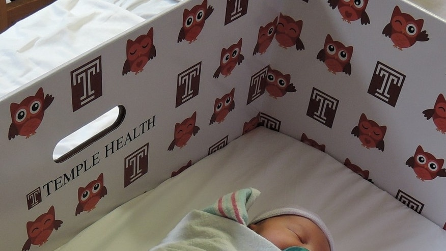 A newborn in a Temple University Hospital baby box, which serves as a bassinet. (image courtesy Temple University Hospital)