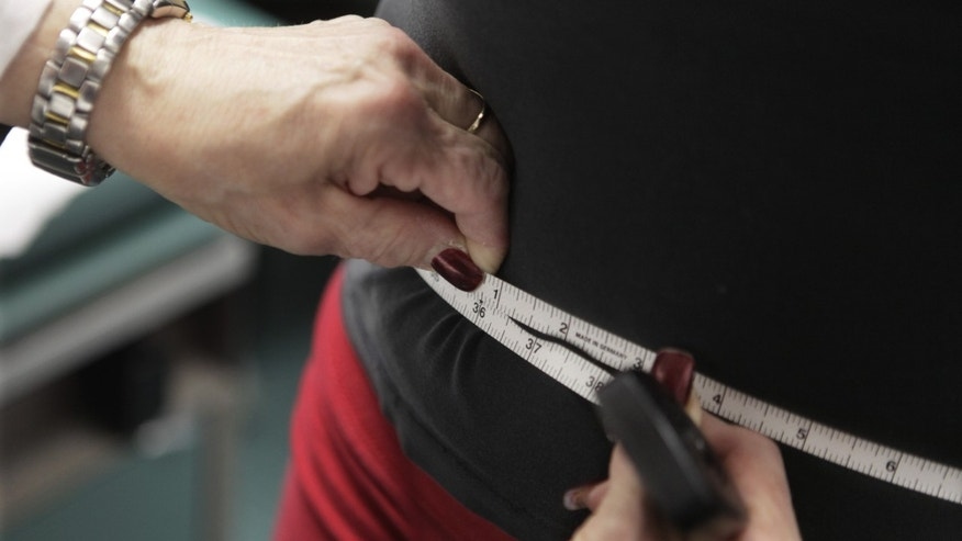 In this Jan. 20, 2010, file photo, a waist is measured during an obesity prevention study at Rush University Medical Center in Chicago.
