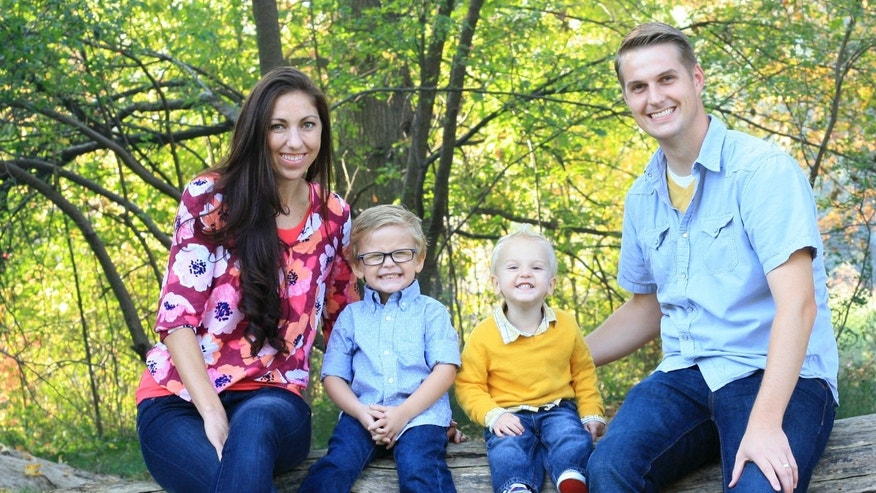 "Spencer and Whitney Blake pose for a photo with their two sons, who are adopted. ""Infertility is what led us to adoption, and that's what led us to our little boys,"" Whitney told Fox 9. ""We firmly believe that our family is just the way it was meant to be."""