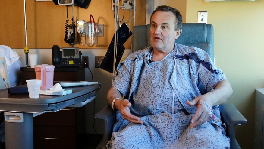 Thomas Manning, of Halifax, Mass. speaks from his hospital room at Massachusetts General Hospital, Wednesday, May 18, 2016, in Boston. Manning is the first man in the United States to undergo a penis transplant. He received the organ from a deceased donor. (AP Photo/Elise Amendola)