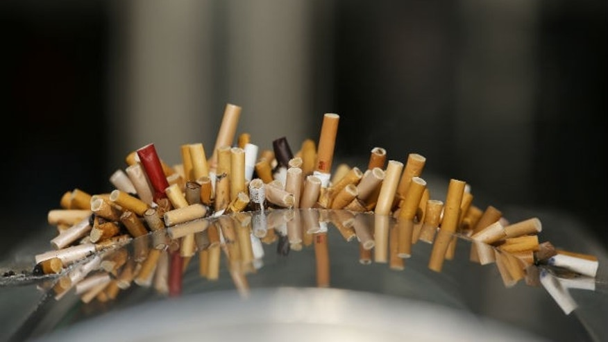 Extinguished cigarettes are seen in an ashtray at the Shanghai Railway Station (REUTERS/Aly Song)