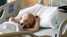 May 22, 2015: Landon Kimich, 2, sleeps as he receives a chemotherapy treatment for neuroblastoma at Houston's M.D. Anderson Cancer Center.