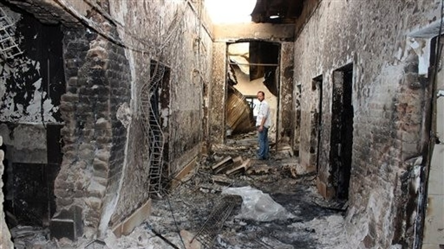Oct. 16, 2015: In a file photo, an employee of Doctors Without Borders stands inside the charred remains of their hospital after it was hit by a US airstrike in Kunduz, Afghanistan.