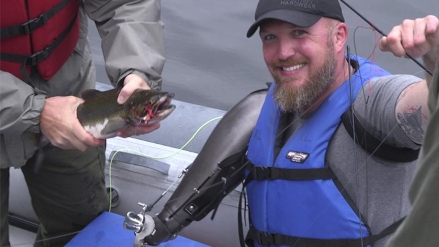 "Army Major Ed ""Flip"" Klein fishing in Alaska after being fitted with a 3-D printed prosthetic attachment at Walter Reed National Military Medical Center."