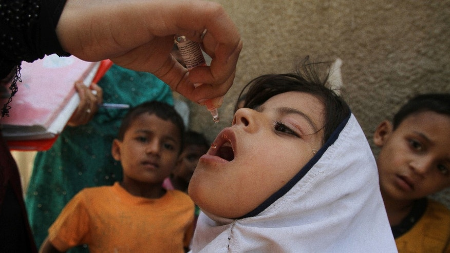 FILE - In this April 21, 2016 file photo, a Pakistani health worker gives a polio vaccine to a girl during a campaign in Karachi, Pakistan. For the first time in Pakistan's history all the previous month's environmental samples for polio have tested negative, a sign of progress in the campaign to eradicate the virus, an official said Monday, May 30, 2016. (AP Photo/Fareed Khan, File)