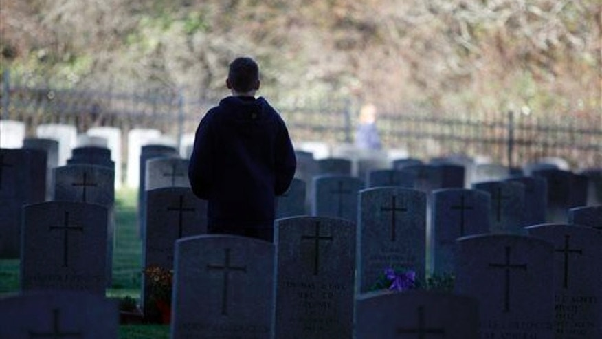 A young man stands in a cemetery in Victoria, British Columbia, in this file photo.