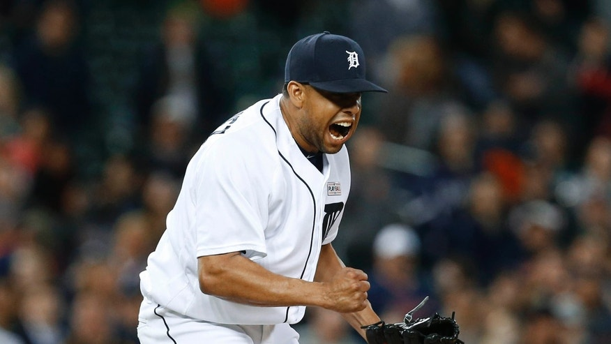 Detroit Tigers relief pitcher Francisco Rodriguez reacts to striking out Minnesota Twins right fielder Miguel Sano in the ninth inning of a baseball game ,Monday, May 16, 2016 in Detroit.