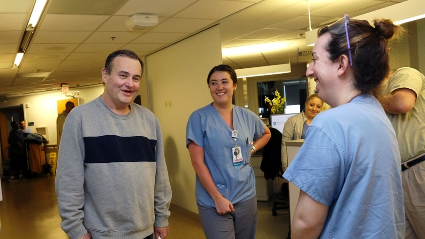 Thomas Manning, of Halifax, Mass., chats with nurses, Caroline Pinnette, middle, and Ashley DiPaolo as he prepares to be discharged from Massachusetts General Hospital, Wednesday, June 1, 2016, in Boston. Manning is the first man in the United States to undergo a penis transplant. (AP Photo/Elise Amendola)