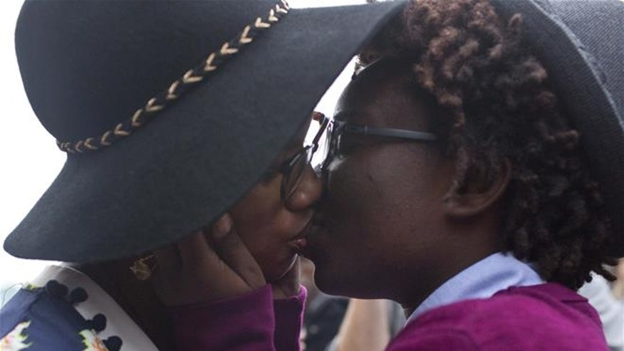 Two women share a kiss in Montgomery, Ala.