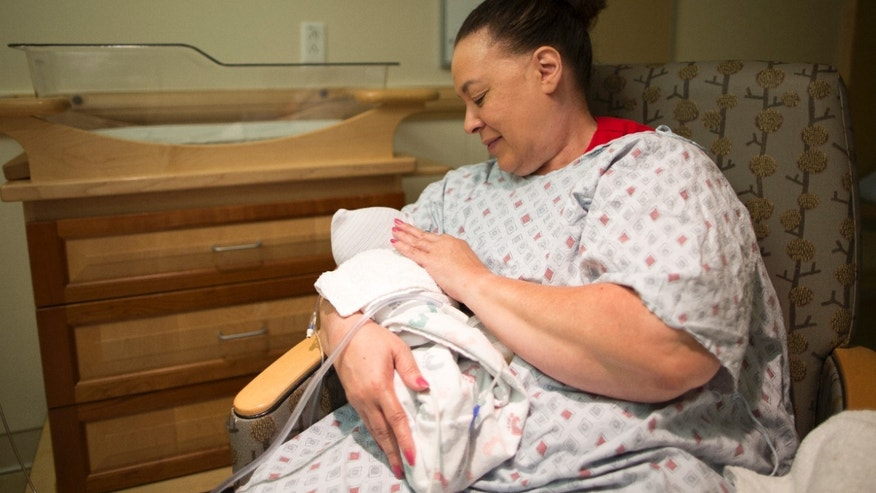Beverly Thorton, a volunteer at Magee-Womens Hospital of UPMC in Pittsburgh, cuddles babies addicted to opioids and often sings to soothe them.