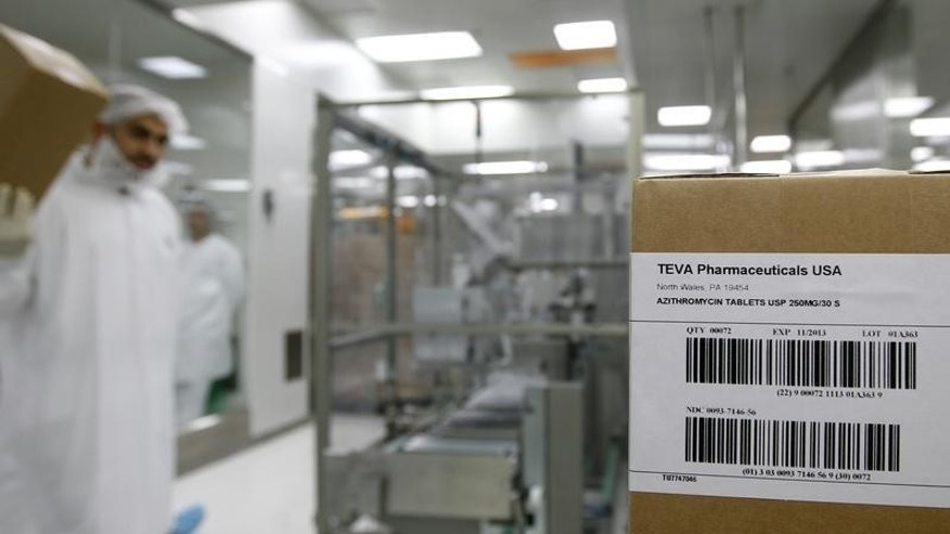 An employee of Teva Pharmaceutical Industries carries a box in Jerusalem oral solid dosage plant
