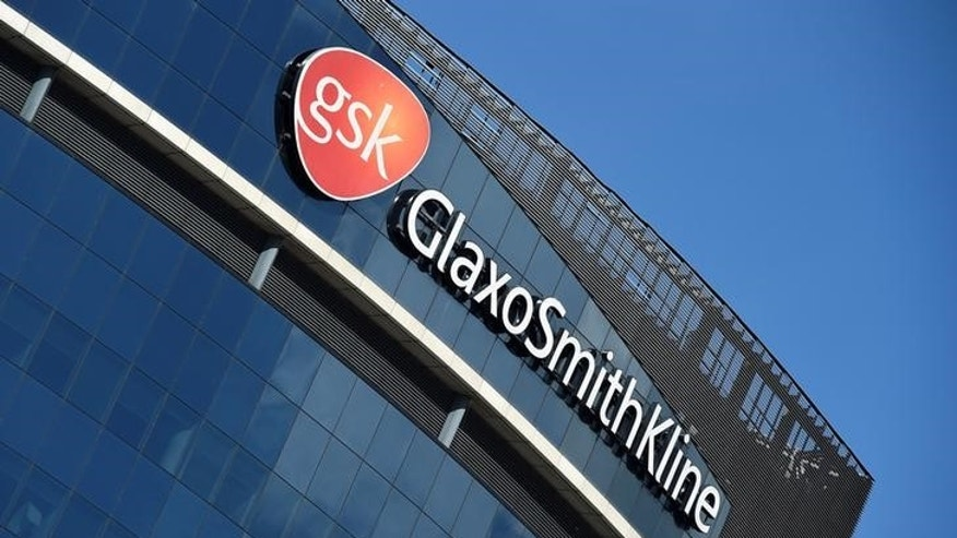 Signage for GlaxoSmithKline is seen on its offices in London, Britain