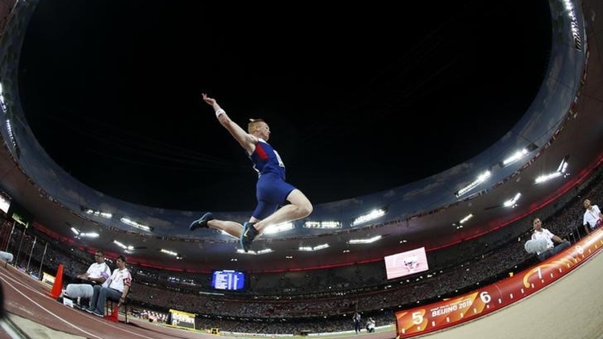 Britain's Rutherford competes to win the men's long jump final during the 15th IAAF World Championships at the National Stadium in Beijing