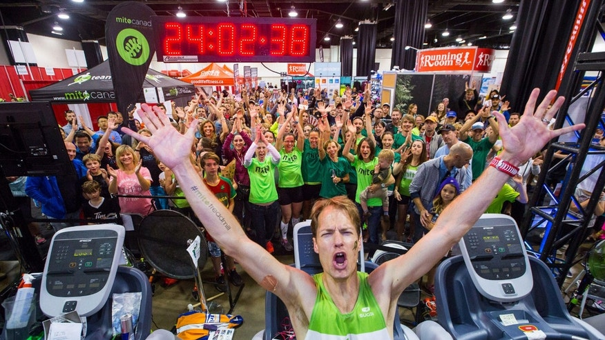 Dave Proctor celebrates setting the 24-hour treadmill record. (Photography by Neil Zeller)