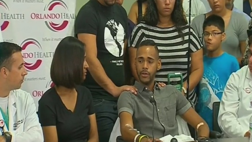 Orlando shooting victim Angel Colon addresses reporters Tuesday.