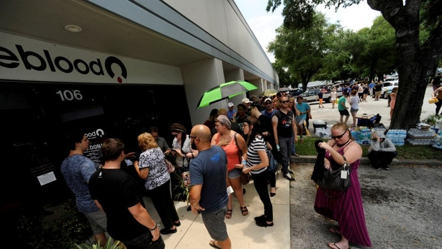Hundreds of community members line up outside a clinic to donate blood after an early morning shooting attack at a gay nightclub in OrlandoS