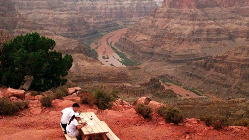 A couple enjoy lunch on one of the scenic points at Grand Canyon West on the Hualapai Indian reservation in Arizona. A new study published in the journal Science suggests the western Grand Canyon formed 70 million years ago.