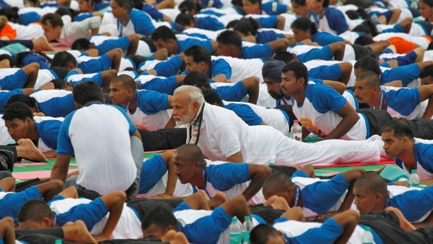 India's PM Modi performs yoga during World Yoga Day in Chandigarh