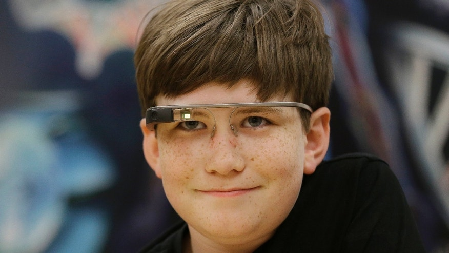 Julian Brown smiles while wearing Google Glass glasses and talking with Jena Daniels, a clinical research coordinator at The Wall Lab in Stanford, Calif., Wednesday, June 22, 2016.