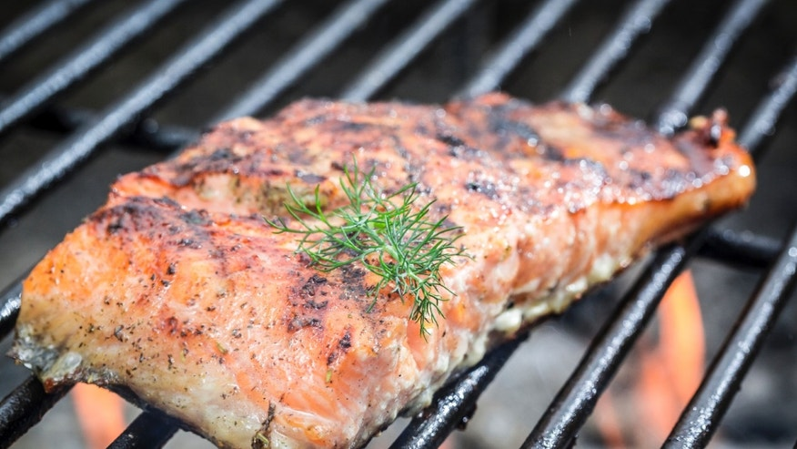 Baked salmon on the grill with fire