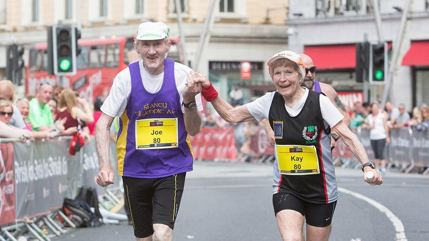 Kay and Joe O'Regan grasp hands as they approach the finish line of the 2016 Cork City Marathon. (photograph courtesy of Cork City Marathon)