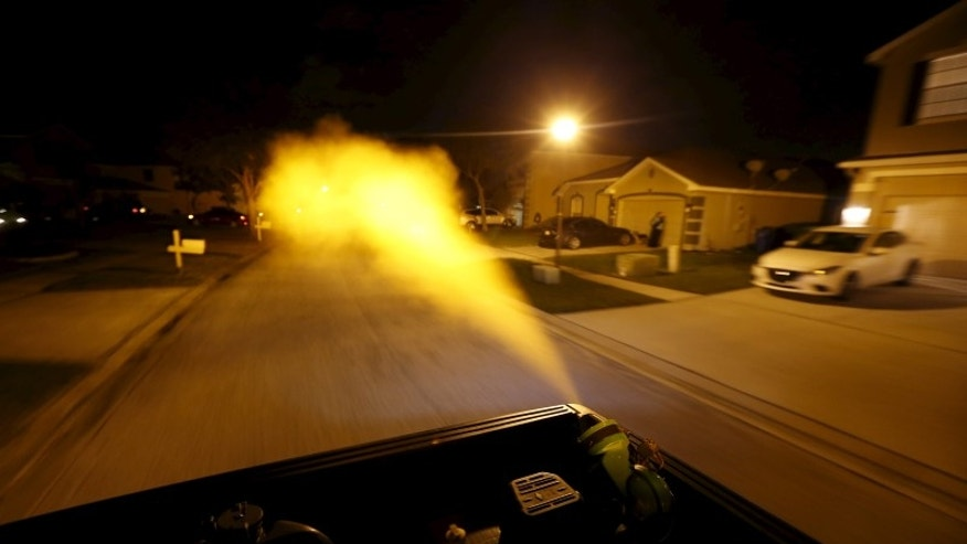 Hillsborough County mosquito control drives through a neighborhood spraying against mosquitos in Hillsborough County, Florida,