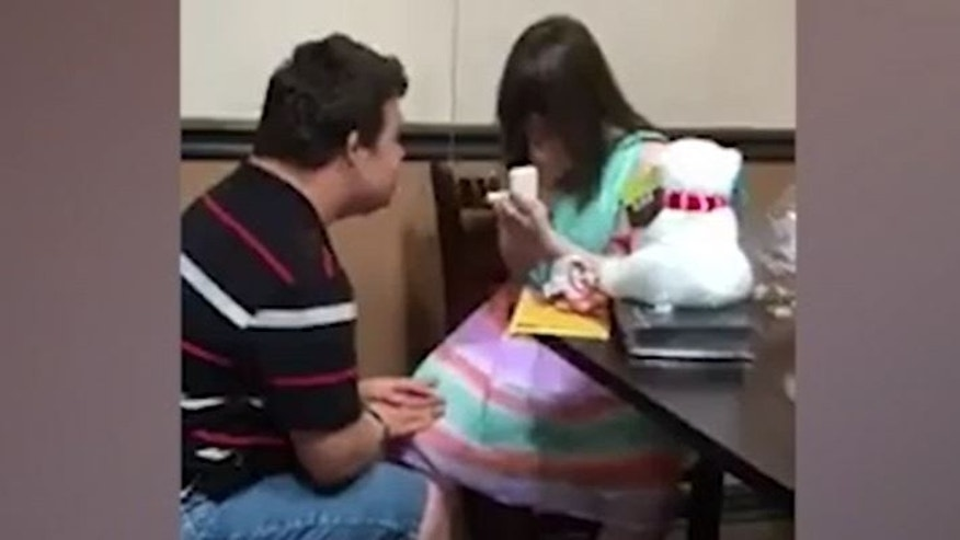 Reaction priceless as woman with Down syndrome receives promise ring