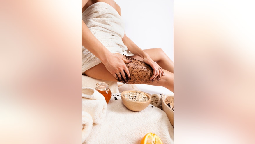 Beautiful woman taking care of her body with natural products at home. Natural massage with coffee beans and honey.Selective focus. Mode body care and natural products in this lightboxes: