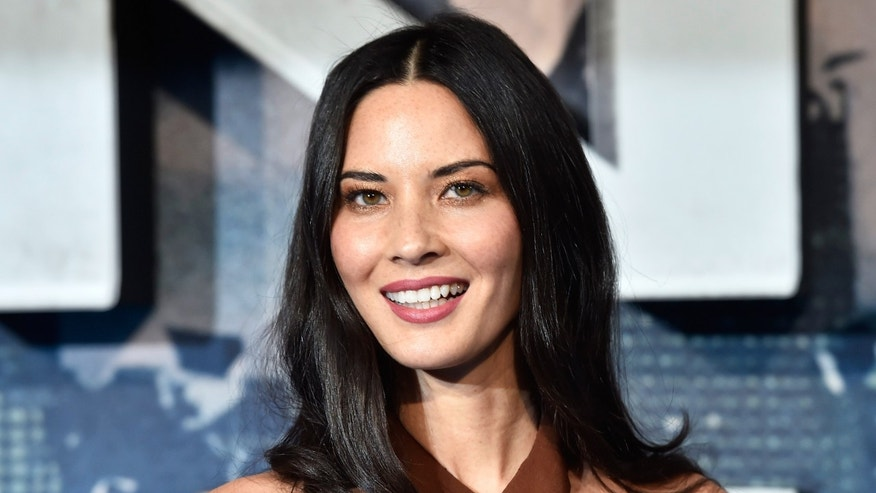 Actress Olivia Munn arrives at a screening of X-Men Apocalypse at a cinema in London, Britain, May 9, 2016.