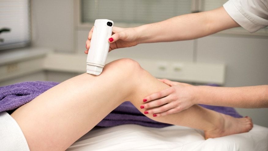 Hair removal cosmetology procedure from a therapist at cosmetic beauty spa clinic.