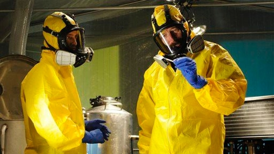 "Jesse Pinkman, played by Aaron Paul, left, and Walter White, played by Bryan Cranston, cooking meth in a home being fumigated in the fifth season of ""Breaking Bad."""