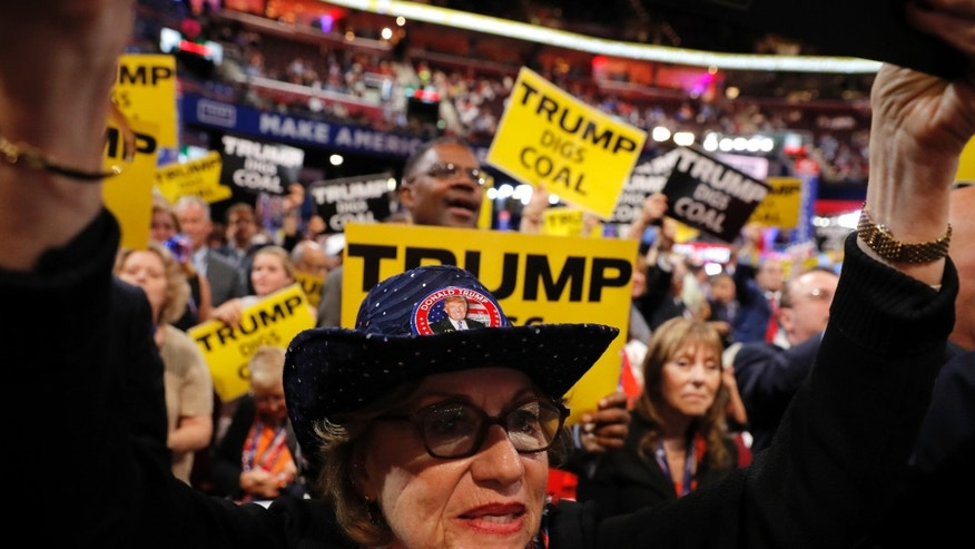 Trump supporter Carol Sides celebrates at the Republican National Convention in Cleveland, Ohio, U.S. July 19, 2016.