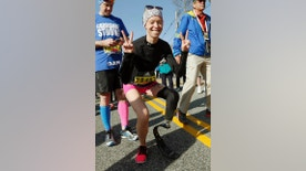 FILE - In this April 18, 2016, file photo, Boston Marathon bombing survivor Adrianne Haslet poses at the starting line in Hopkinton, Mass., before running in the 120th Boston Marathon. On Sunday, July 24, 2016, Davis reached the summit of Volcan Cayambe, Ecuador's third-highest mountain, with a team of climbers from the Range of Motion Project. The nonprofit group helps provide prosthetic limbs to people around the world who don't have access to them. (AP Photo/Michael Dwyer, File)