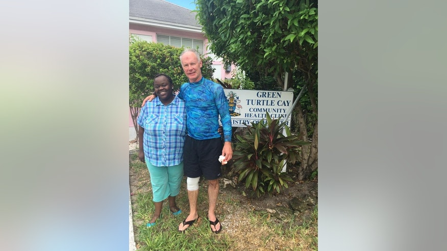Dr. Steve Cutbirth, of Waco, Texas, poses with his Bahamian nurse Shekera after reportedly talking her through how to stitch his wounds.