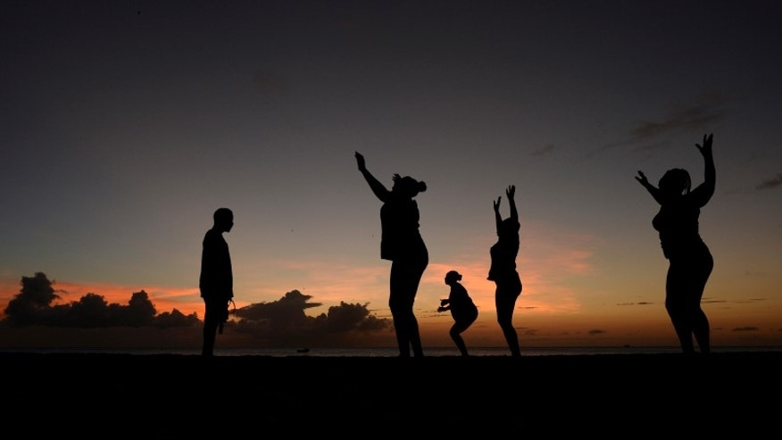 File picture of women exercising in front of a trainer as the sun sets near Kensington Oval in Bridgetown, Barbados